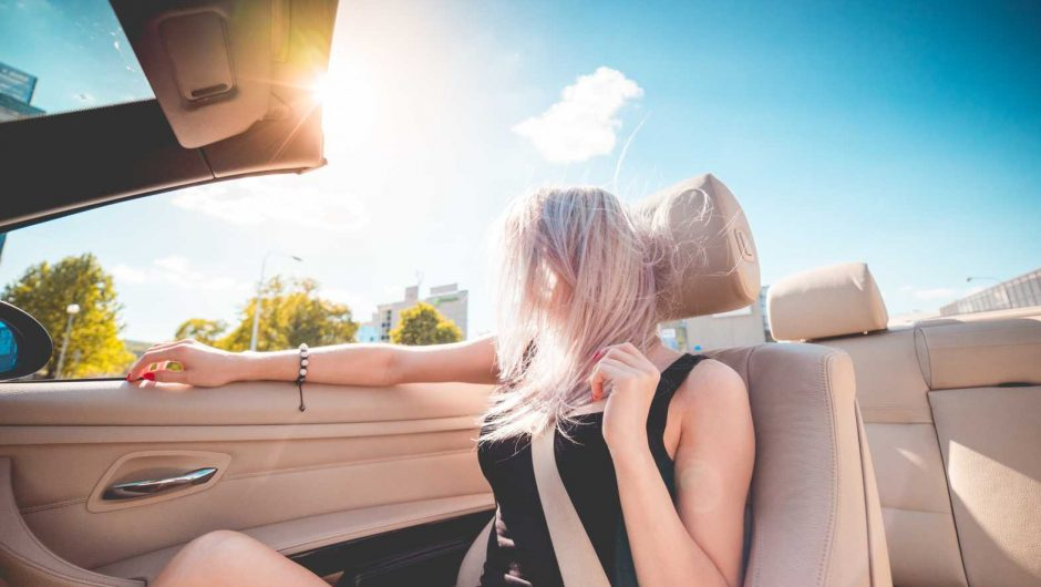 Young Blonde Girl on Summer Ride in Convertible